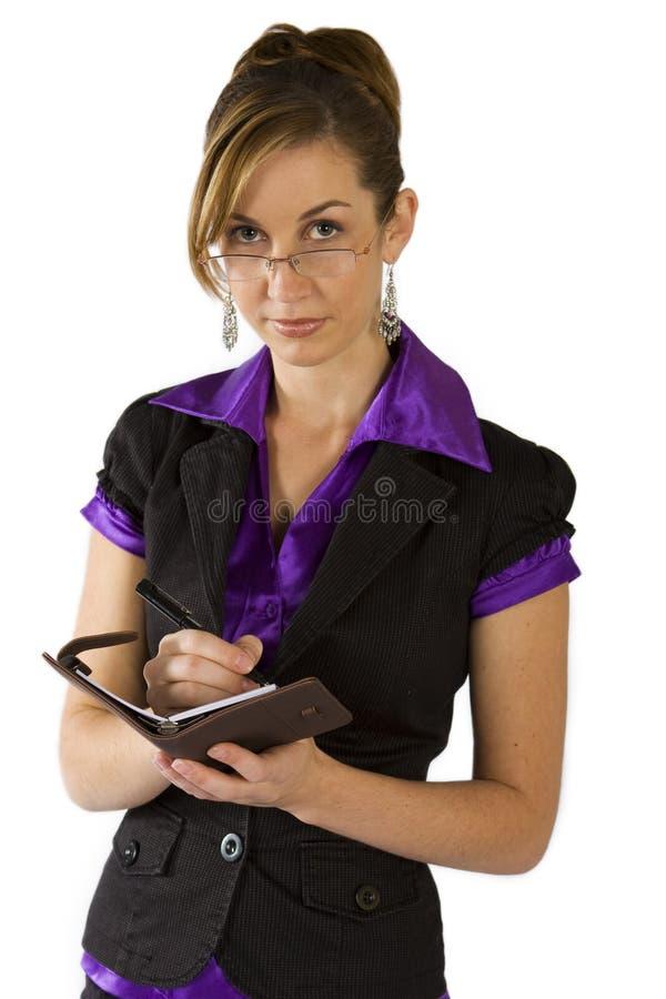 Planification de femme d'affaires son jour images stock