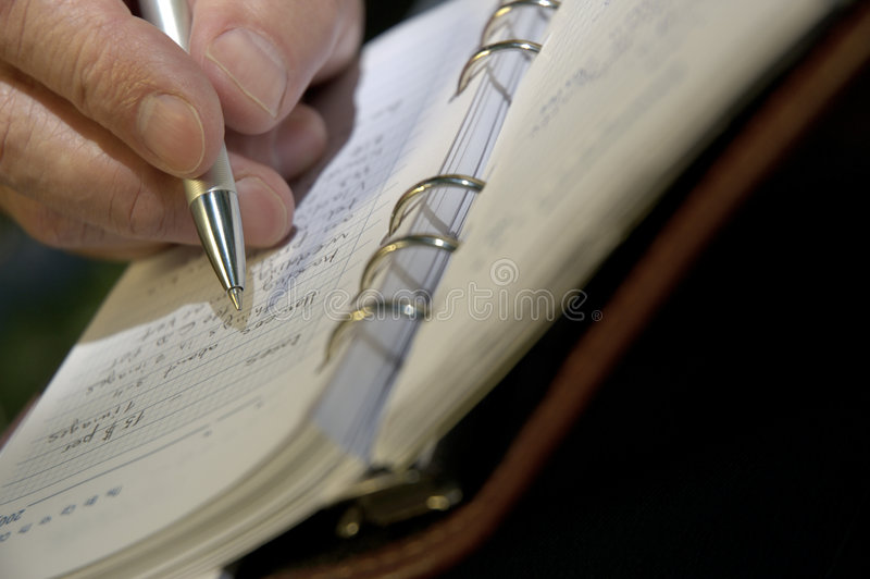 Planing new day or new deal. Hand,pen and organizer stock photos