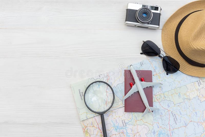 Planing Summer traveling passport with camera vintage, map, fish star, sun glasses, hat, airplane. Travel in the holiday, Top vie. W white wooden and copy space royalty free stock image
