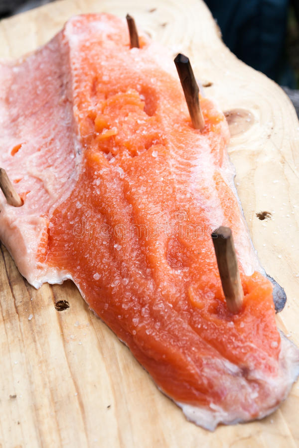 Plank cooked salmon royalty free stock image