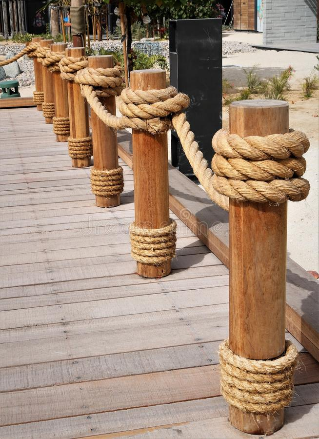 Rope fence. Plank footpath and fence boundary rope barrier on the beach stock images