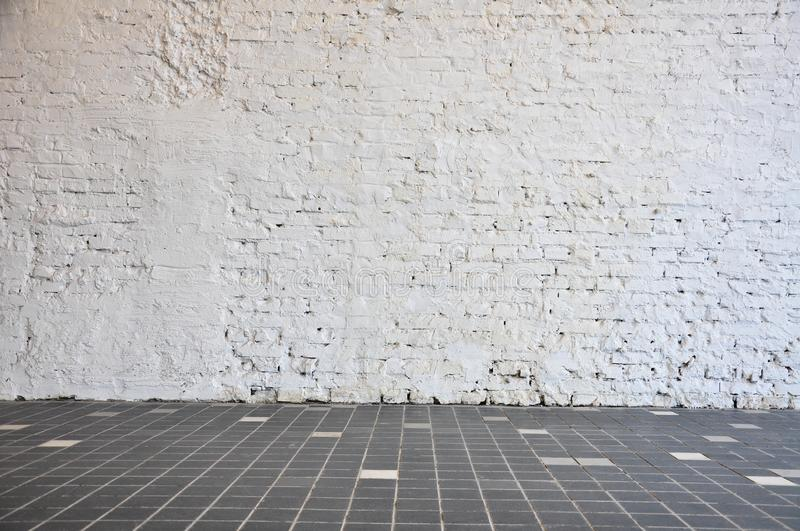Empty room with brick wall and wood floor. Blank Stone floor with white brick wall background royalty free stock image