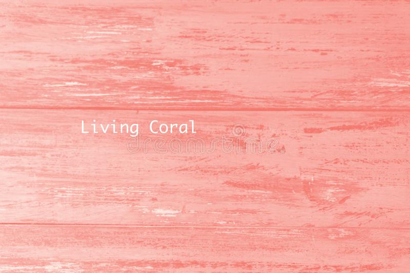 Plank texture of wood table painted in Living Coral color of the Year. Trendy pastel coloured background. royalty free stock photo
