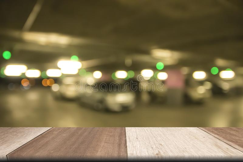 Plank wooden table on front Defocused blurred car park royalty free stock photos
