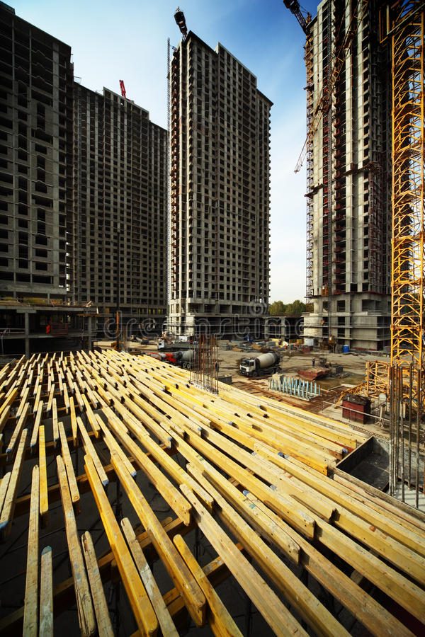 Download On Planking Between Buildings Under Construction Stock Photo - Image of carry, engineering: 20004310