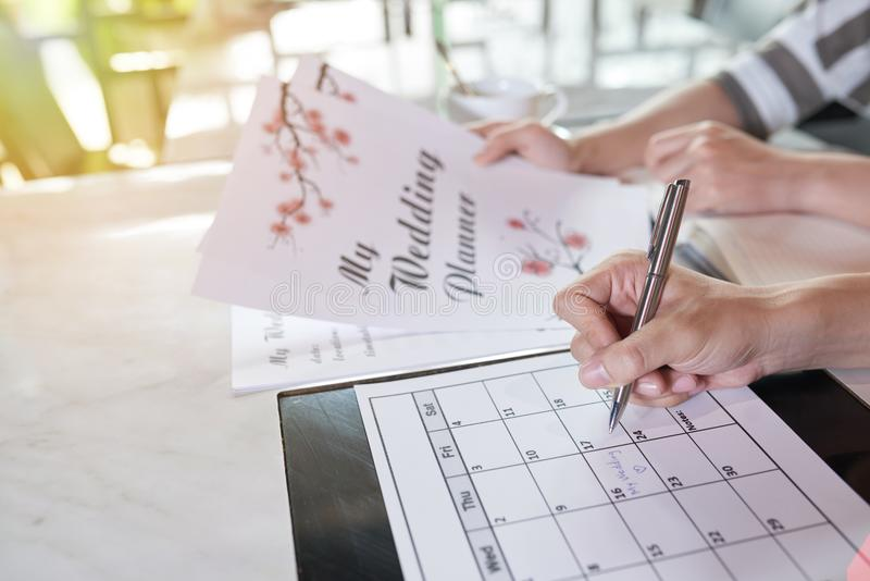 Planläggningsbröllopdag arkivfoto