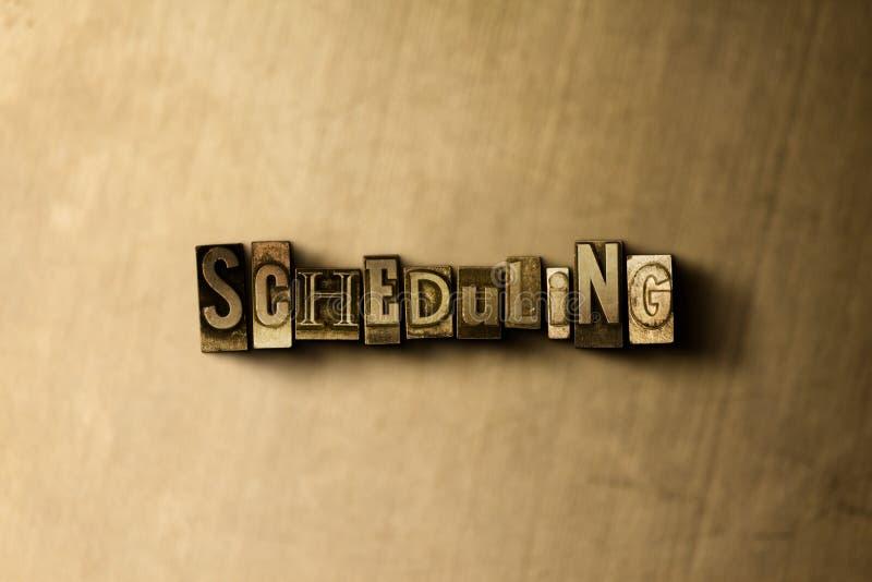 PLANLAGD - närbild av det typsatta ordet för grungy tappning på metallbakgrunden arkivfoton