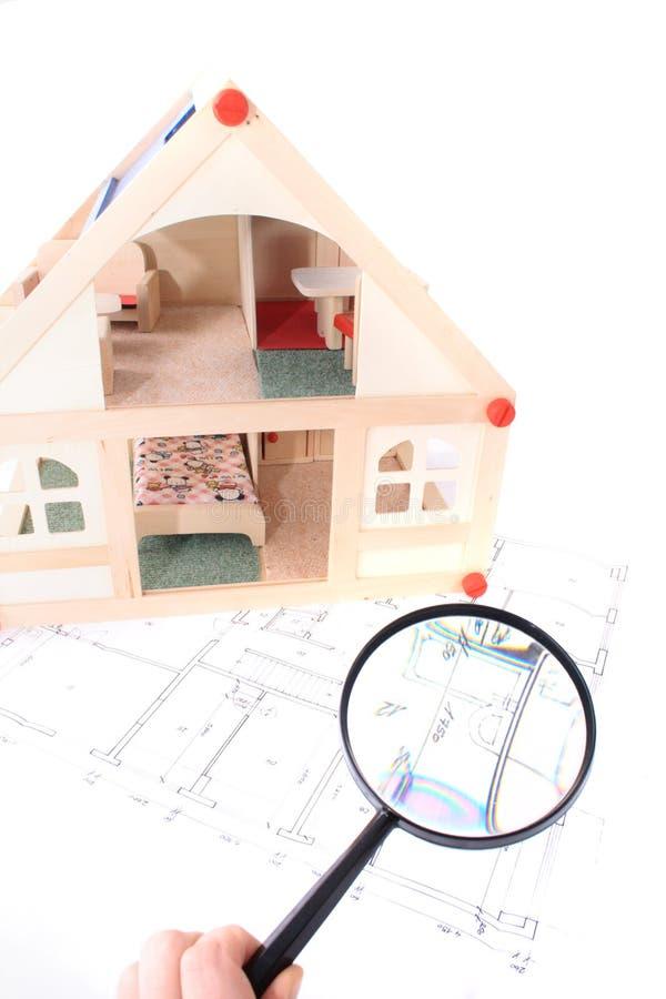Plannen en model van huis stock afbeeldingen