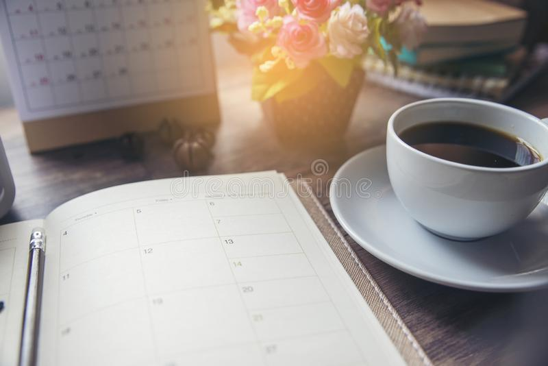 Planner and Calendar Concept.Desktop Calender 2019,cup of coffee place on office desk.Notebook for Planner to make timetable, stock photos