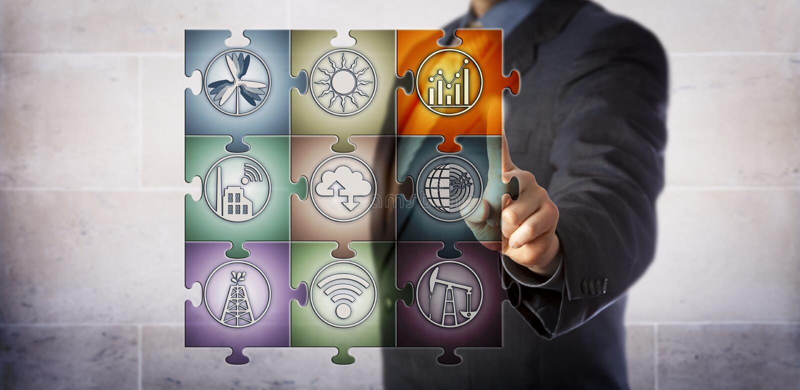 Planner Controlling Smart Energy Management. Blue chip plant manager touching chart icon in virtual planning matrix in form of a jigsaw puzzle. Industry concept stock image