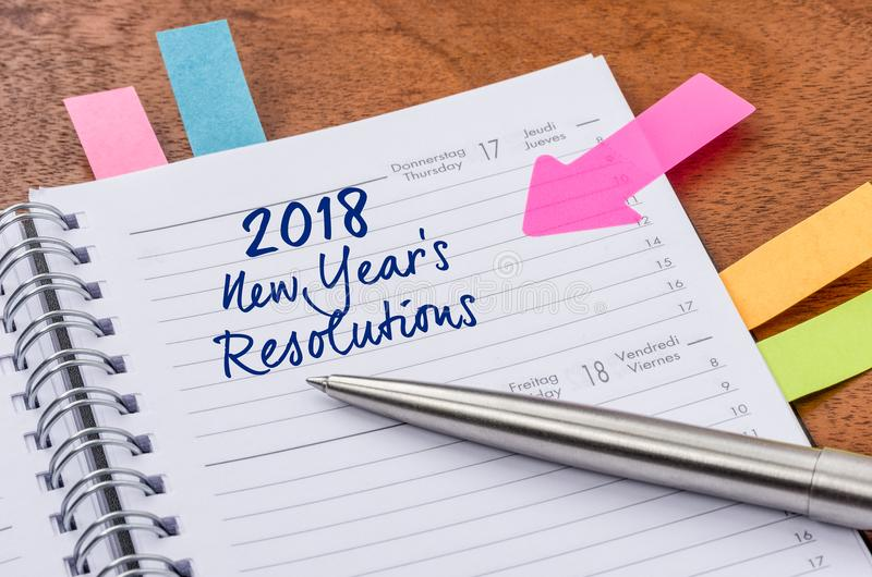 Planner with the entry New Years Resolutions 2018. Daily planner with the entry New Years Resolutions 2018 stock image