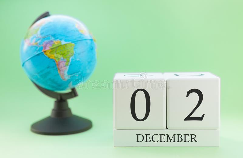 Planner wooden cube with numbers, 2 day of the month of December, winter royalty free stock photography