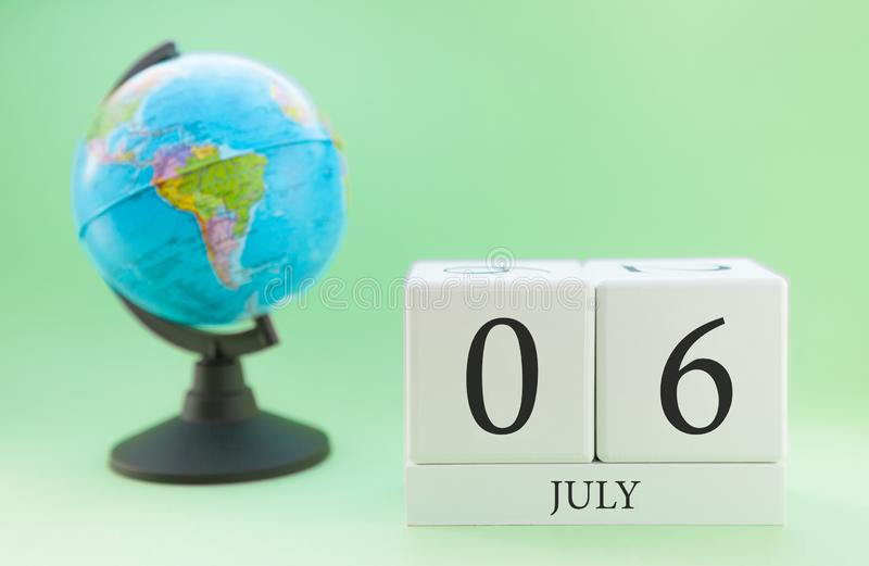 Planner wooden cube with numbers, 6 day of the month of July, summer royalty free stock photography