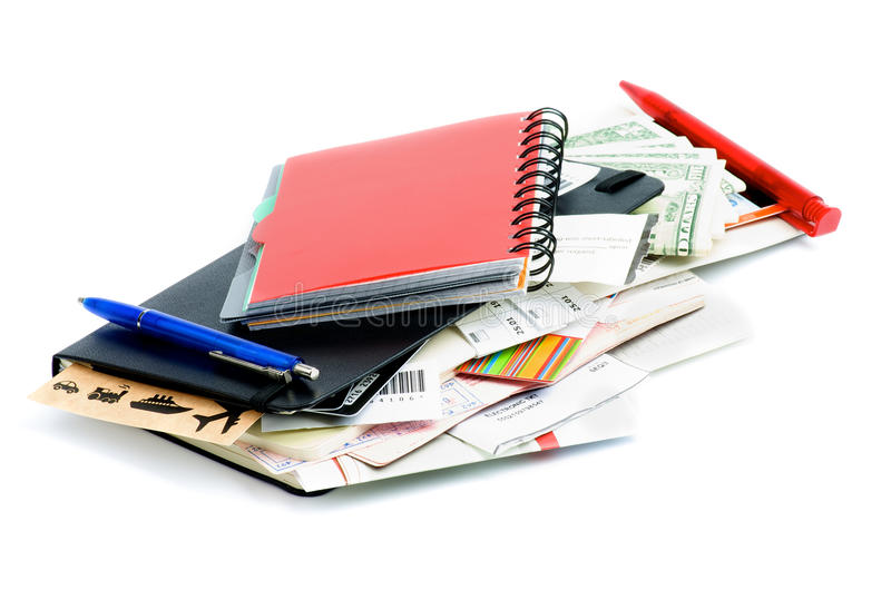 Planning Adventure. Heap of Travel Concept Objects with Planning, Tickets, Currency, Pen and Other Accessories on white background stock image