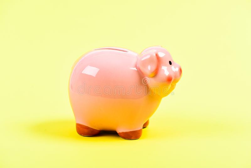 Planning budget. financial problem. money saving. income management. piggy bank on yellow background. Time save Concept. Moneybox for coins with pig face. No stock photo