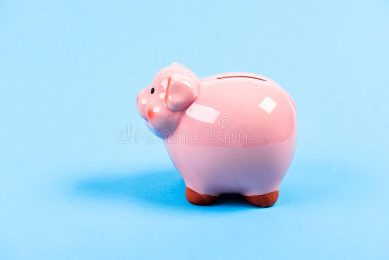 Planning budget. money saving. financial problem. income management. piggy bank on blue background. It is time to pay royalty free stock photo