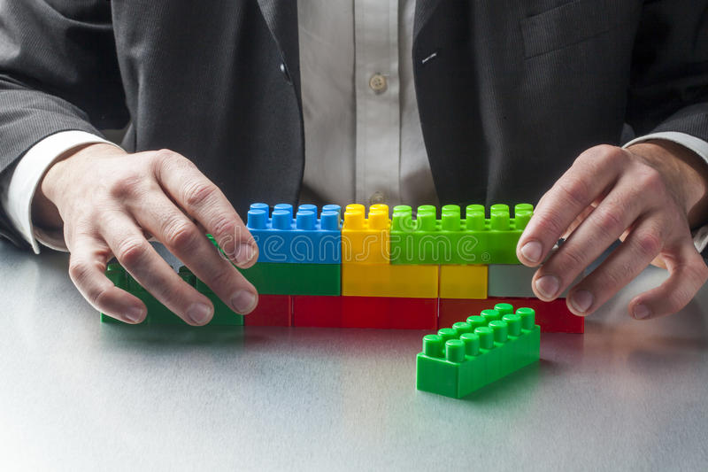 Planning construction with plastic toys at work royalty free stock photography
