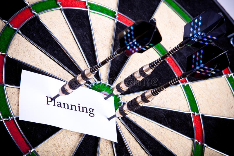 Planning on dartboard. Planning concept on on dartboard witch arrows stock images