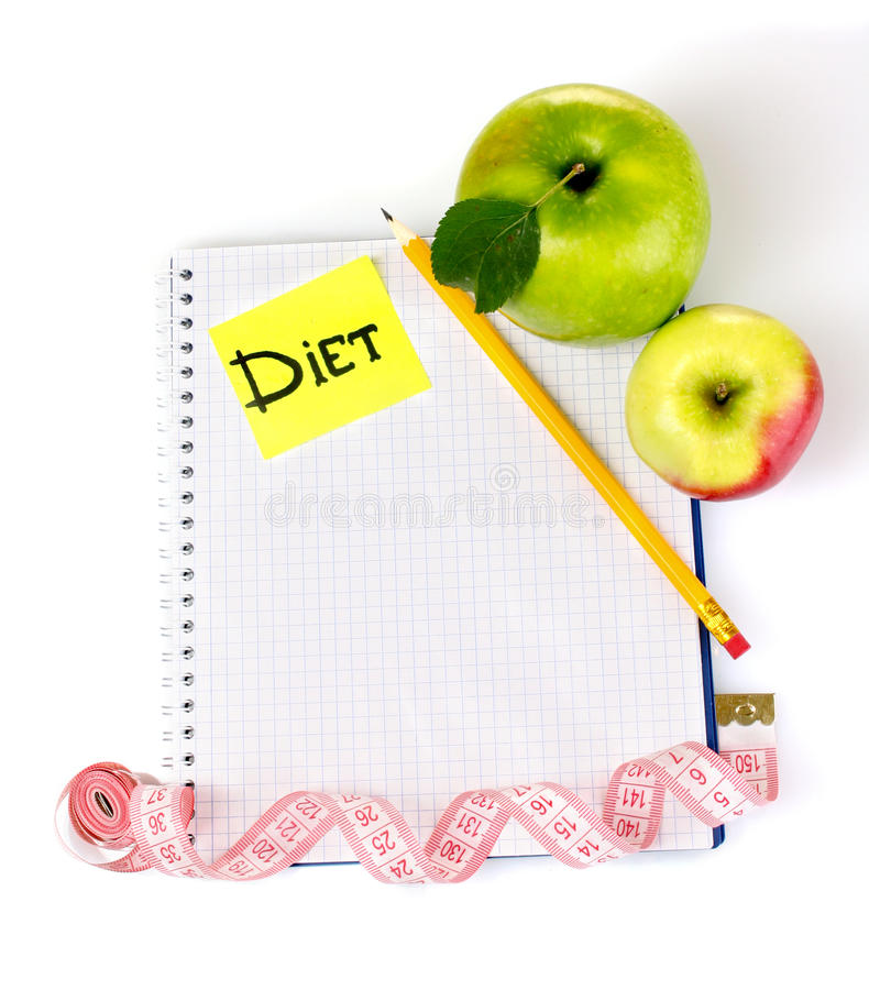 Planning of a diet. Notebook, pencil and apples royalty free stock photography