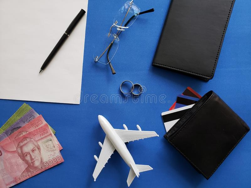 planning the honeymoon trip, rings, eyeglasses, chilean banknotes, passports, credit cards and figure of an airplane, top view stock photos