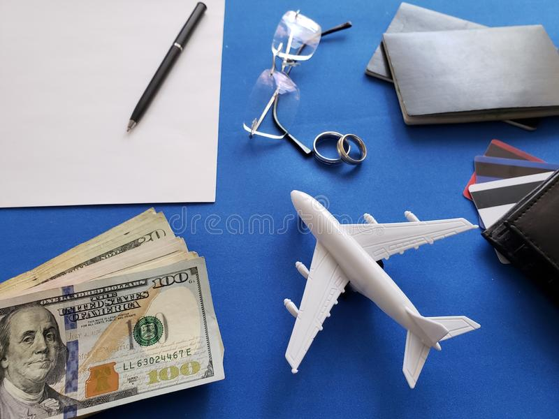 planning the honeymoon trip, rings, eyeglasses, chilean banknotes, passports, credit cards and figure of an airplane, top view royalty free stock photo