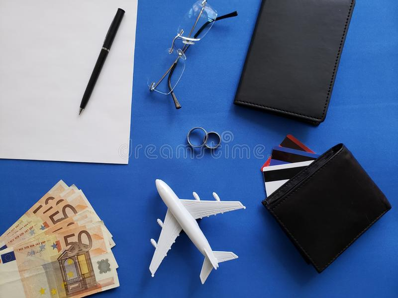 planning the honeymoon trip, rings, eyeglasses, european banknotes, passports, credit cards and figure of an airplane royalty free stock images