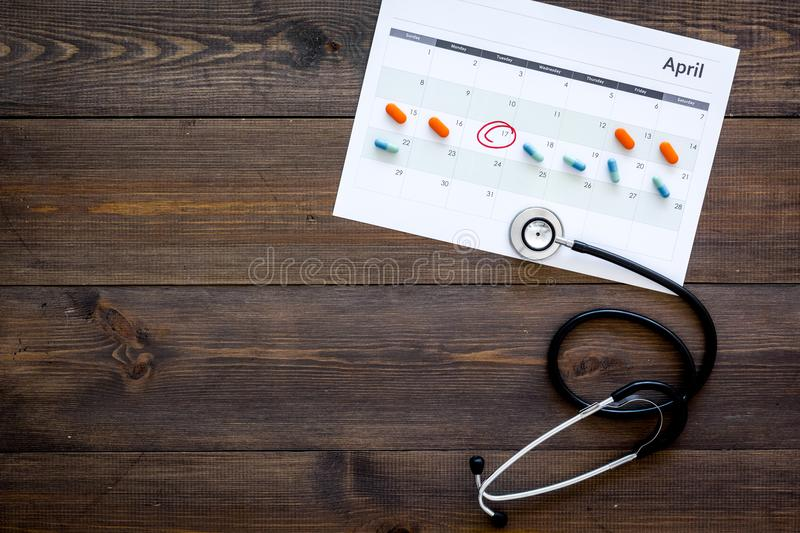 Planning medical examination concept. Regular medical examinations. Calendar with date circled, pills and stethoscope on stock images