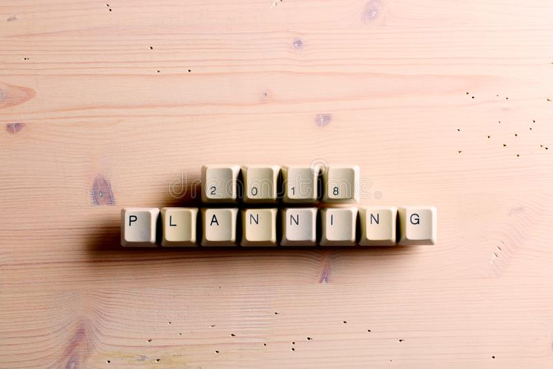 Planning 2018 new year on computer keyboard keys buttons on a wooden background stock photography