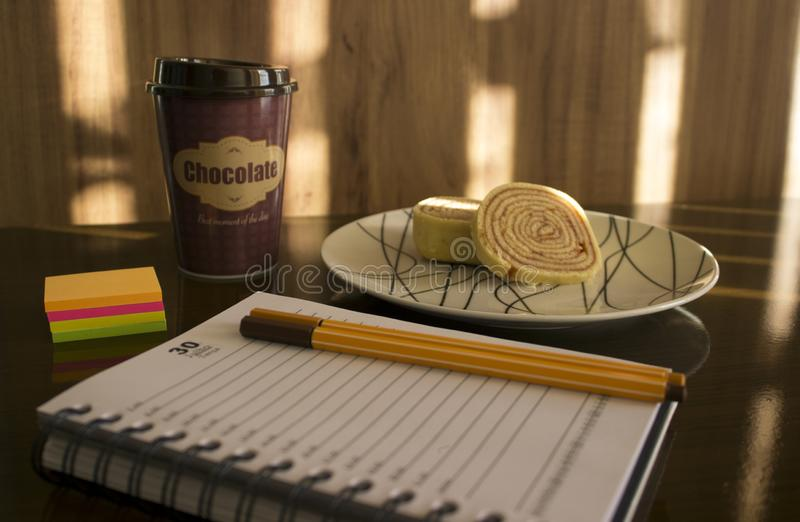Planning next month with hot chocolate and cake royalty free stock image