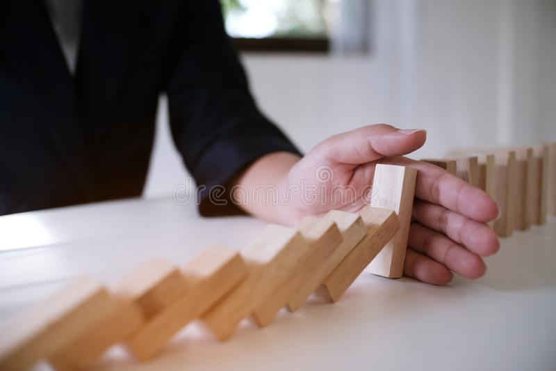 Planning risk and strategy in businessman gambling placing wooden block.Business concept for growth success process stock image