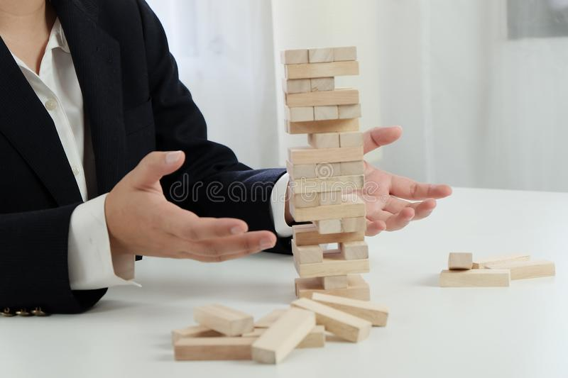 Planning risk and strategy in businessman gambling placing wooden block.Business concept for growth success process. stock photos