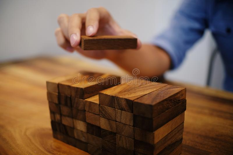 Planning risk and strategy in businessman gambling placing wooden block.Business concept for growth success process stock photo