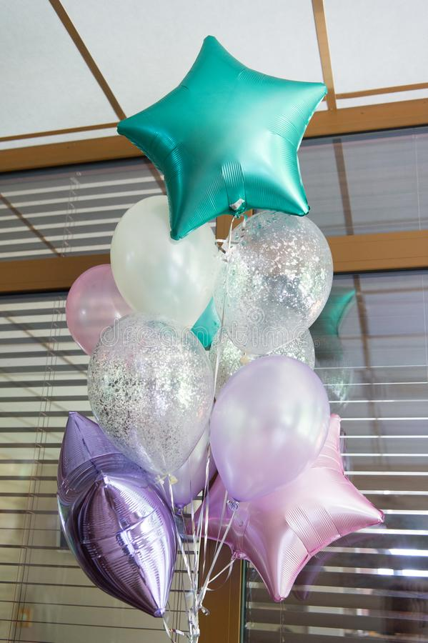Planning special party. Stylish air balloons waiting for party time. Holiday decoration with party balloons. Decorating. The party with lots of helium balloons stock images