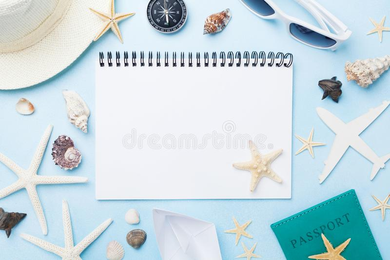 Planning summer holidays, tourism and vacation background. Travelers notebook with accessories on blue desk top view. Flat lay. Planning summer holidays stock image