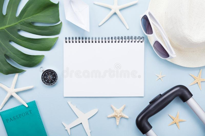Planning summer holidays, vacations and trip. Travelers notebook with tourism accessories on blue table top view. Flat lay. Planning summer holidays, vacations stock images