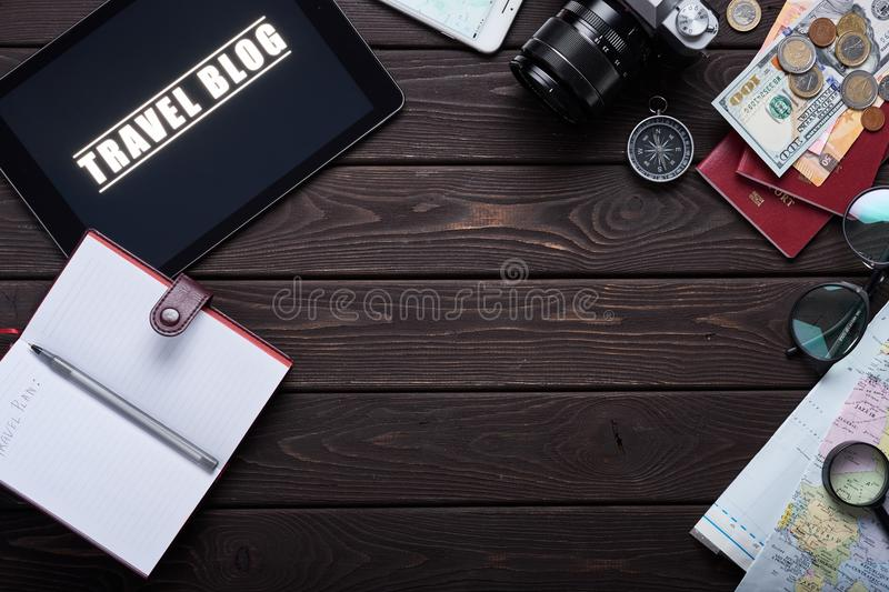 Planning travel. Camera, maps, phone, notepad with money. Thirst travel. royalty free stock images