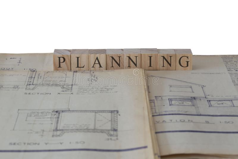 Planning written on wooden blocks on house extension building plans blueprints royalty free stock photo