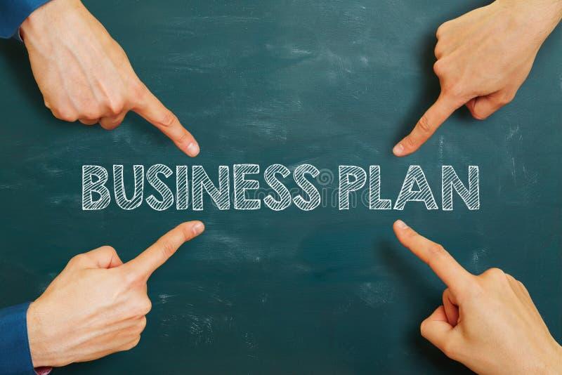 Plano de negócios em um quadro fotografia de stock