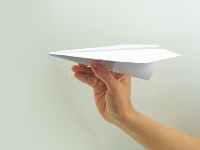 Plano de papel na mão da mulher fotografia de stock