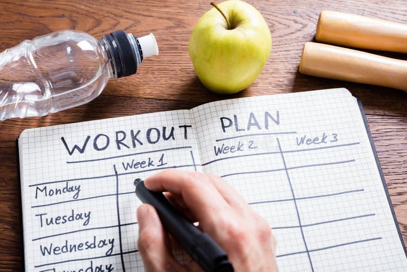 Plano do exercício no caderno fotografia de stock royalty free