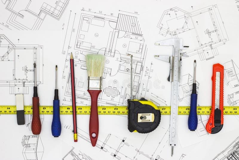 Planos home e ferramentas da renovação foto de stock royalty free