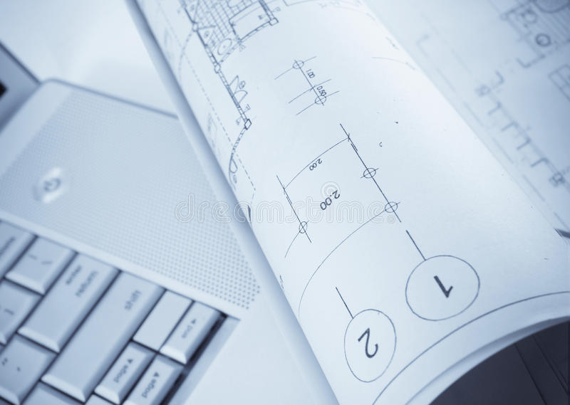 Plans and laptop stock image