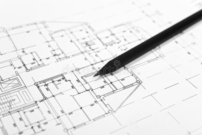 Plans for residential flats with pencil. Closeup stock photography