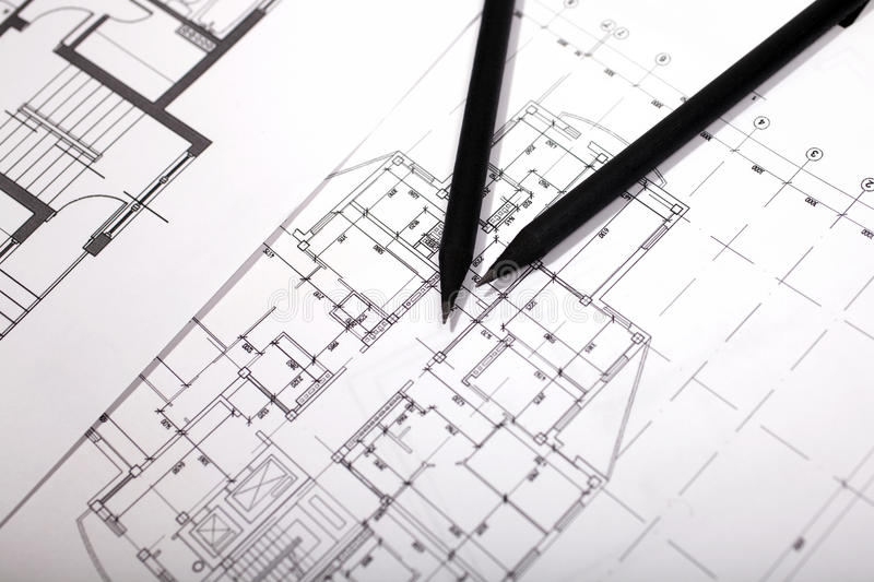 Plans for residential flats with pencil. Closeup royalty free stock images
