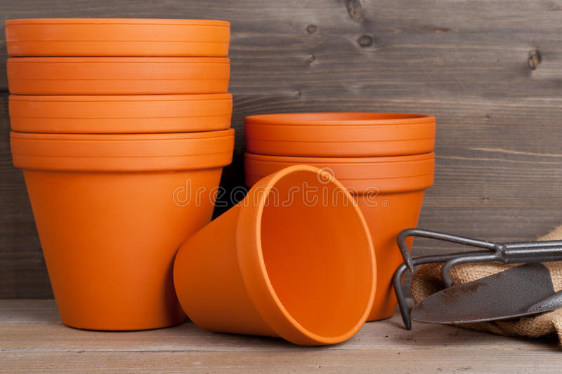 Plant pots and gardening equipment stock images