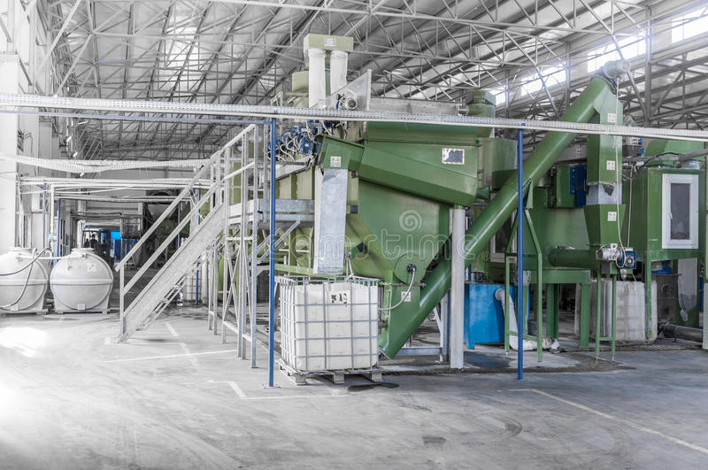 A plant for recycling bottles. Factory equipment for processing and recycling of plastic bottles. PET recycling plant stock photo