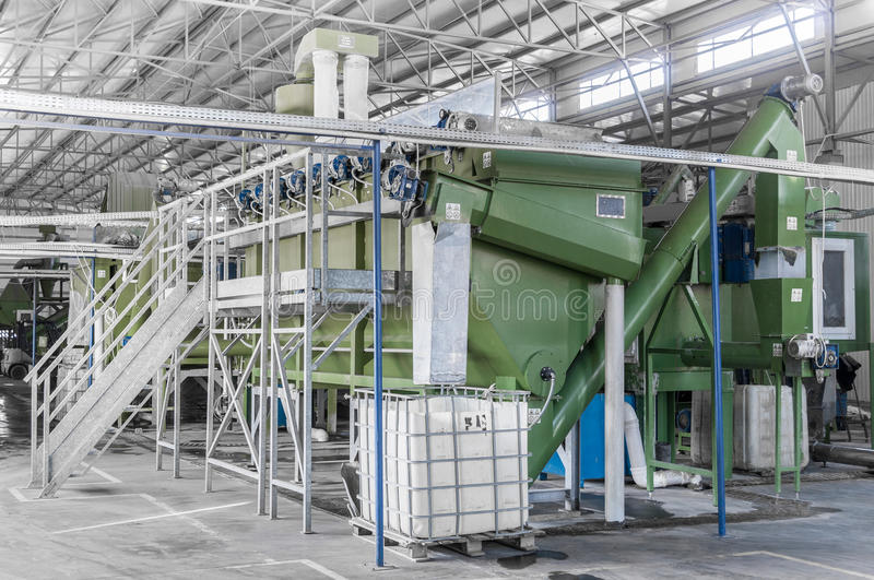 A plant for recycling bottles. Factory equipment for processing and recycling of plastic bottles. PET recycling plant stock photography