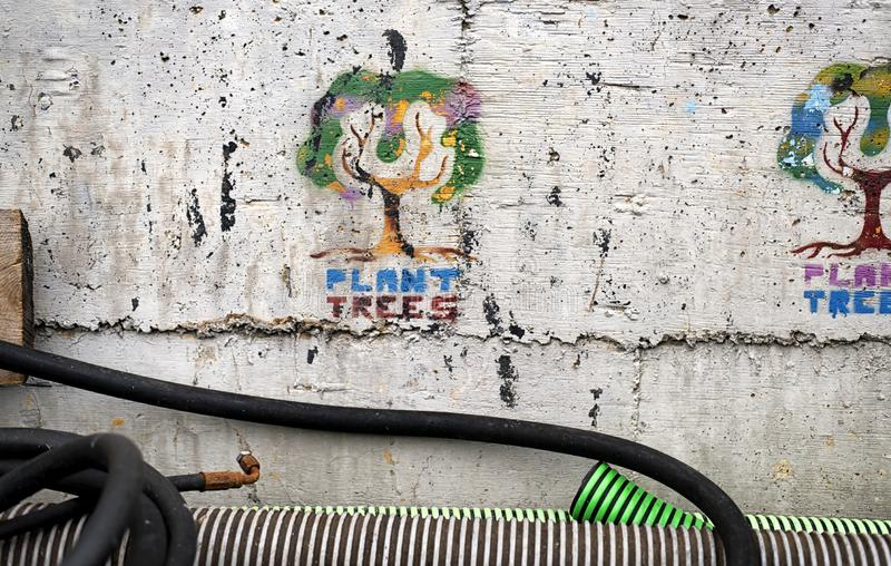 Plant trees cement wall messaging stock photography