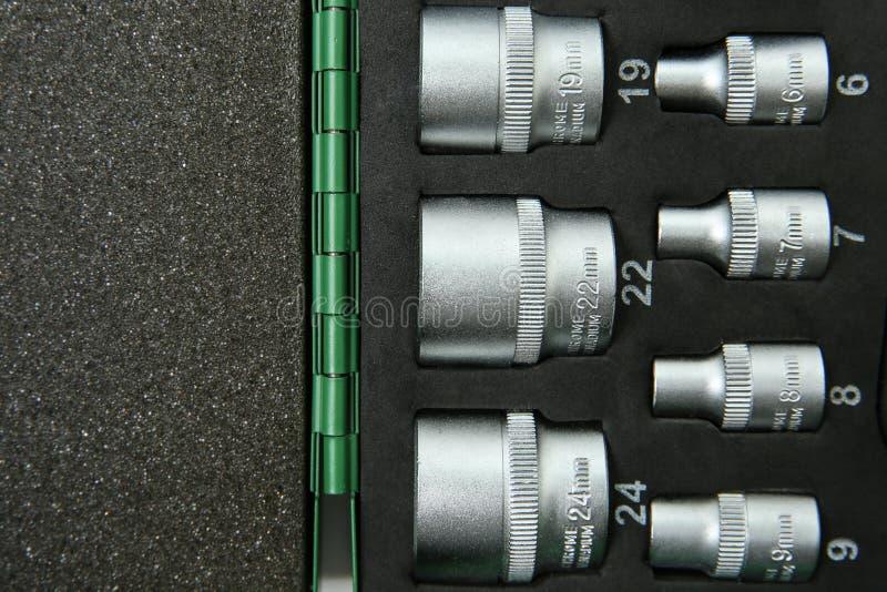 Plantilla de las llaves de zócalo en un caso con gomaespuma con el espacio de la copia imagenes de archivo