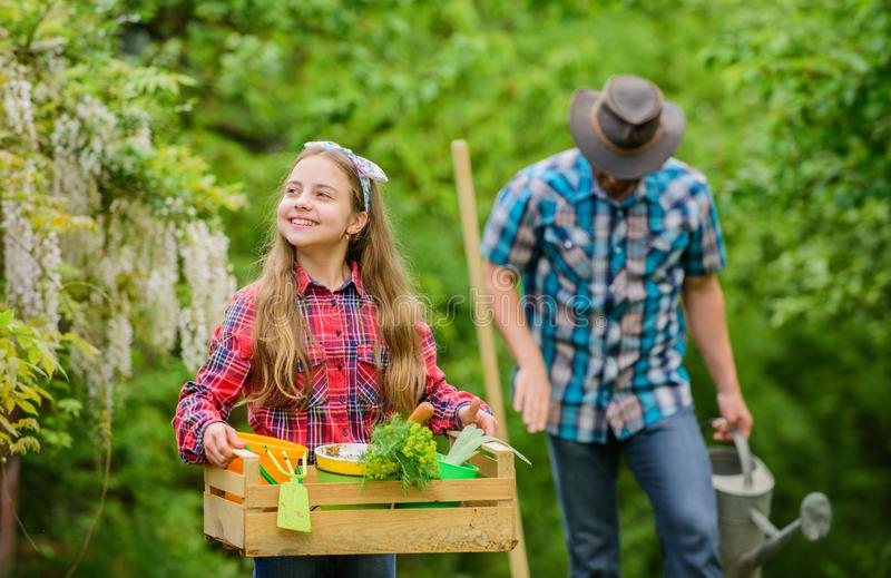 Plants need good care. little girl and happy man dad. earth day. family farm. spring village country. father and. Plants need good care. little girl and happy royalty free stock image